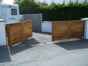 Bespoke, made to measure, Iroko hardwood, bi-folding driveway gates in Newtownards Co Down
