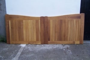 Made to measure Iroko timber driveway gates before fitting