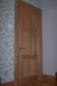 Three panel Victorian style solid Oak door with walnut wedges and matching frame,skirting board and architrave