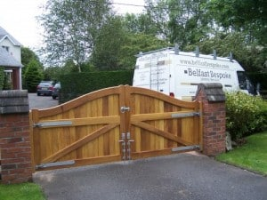 View from the rear of bespoke, curved top, Iroko hardwood driveway gates in Drumbo Co Down