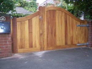Iroko hardwood, 1/3 pedestrian, inward opening and 2/3 driveway gates, outward opening