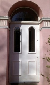 Hardwood, painted, double glazed front entrance door with raised bolection moldings and double glazed, curved fanlight