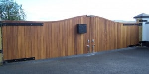 Rear view of galvanised steel framed gates, clad with Iroko hardwood, to fit an opening of 22 feet in Co Londonderry