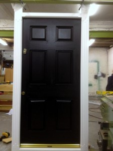 Hardwood, painted, six panel front door with matching painted frame