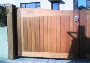 View of Iroko timber gates showing solid Iroko gate post detail in Bangor Co Down