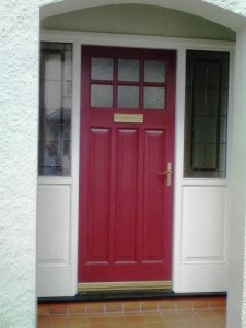 Painted hardwood entrance door and stained glass side lights