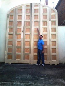 Hardwood arched top, paneled double doors for a television project. 13ft high by 10ft wide.