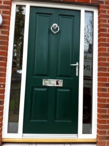 Sapele hardwood, four panel painted entrance door and matching frame with side lights.