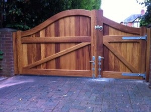 View from the back of iroko hardwood 1/3 pedestrian, and 2/3 driveway gates in South Belfast
