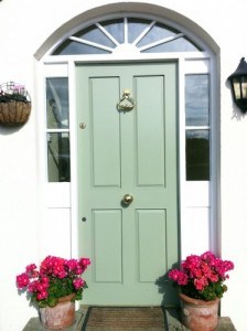 Four panel, painted hardwood entrance door with side lights and top fan light