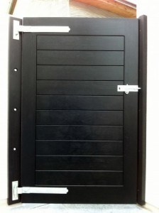 Rear view of Contemporary black hardwood security gate