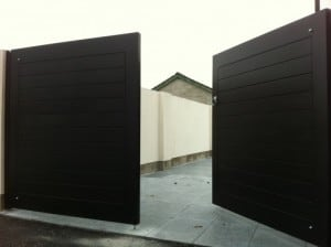 Contemporary black hardwood entrance gates