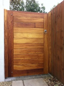 Contemporary iroko hardwood pedestrian gate