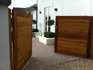 contemporary iroko hardwood entrance gates