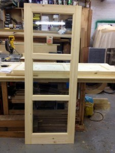 Three panel glazed redwood internal door