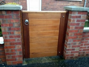 Contemporary Iroko hardwood pedestrian gate in East Belfast