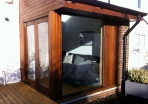 Mahogany double glazed bi-fold doors with full size matching window and cladding