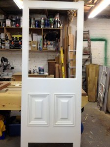 Painted hardwood, four panel Victorian front door