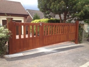 Mahogany, open top driveway gates with matching Mahogany posts in East Belfast