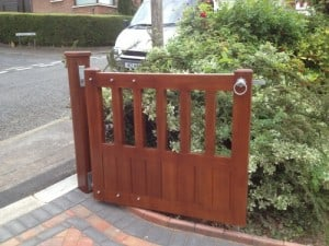 Mahogany, open top pedestrian gate with matching mahogany post in East Belfast