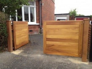 Contemporary, Iroko hardwood entrance gates with matching Iroko hardwood posts