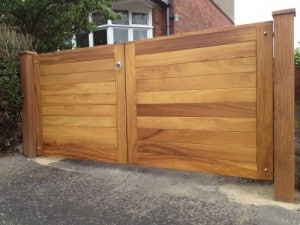 Contemporary, Iroko hardwood entrance gates with matching Iroko hardwood posts in East Belfast