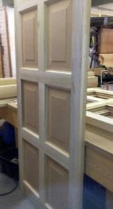 Hardwood, raised, six panel door for a television project