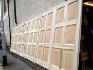 A batch of seven hardwood, raised panel doors for a television project