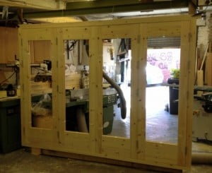 Redwood bi-folding doors with matching frame and sill