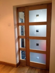 Contemporary, oak glazed door with matching frame and sidelight