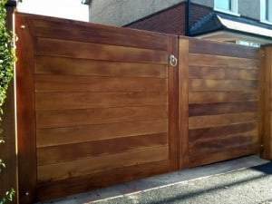 Iroko Hardwood Driveway gates with matching posts in East Belfast