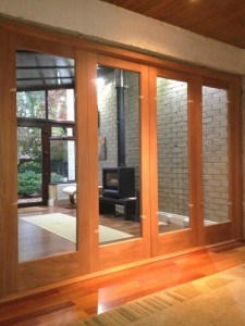 Mahogany, four leaf bi-folding doors with matching frame and sill