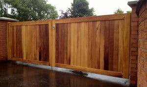 Contemporary, made to measure Iroko hardwood entrance gates in Co Antrim