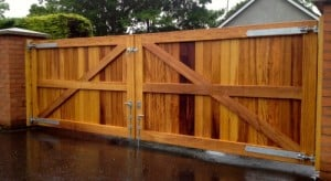 Rear view of contemporary Iroko hardwood entrance gates in Co Antrim
