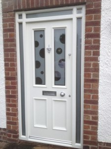 Painted,hardwood, double glazed front door and matching frame with sandblasted decorative glass.