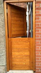 Stained, contemporary, redwood stable door and matching frame