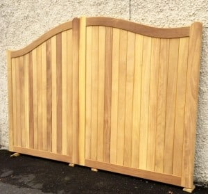Bespoke curved top Iroko entrance gates, supplied for a client in Dublin