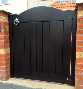 Hardwood,stained ebony colour, curved top pedestrian gate in Redburn Co Down