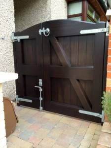 Rear view of hardwood, stained ebony colour 2/3 and 1/3, curved top side gate in Redburn Co Down
