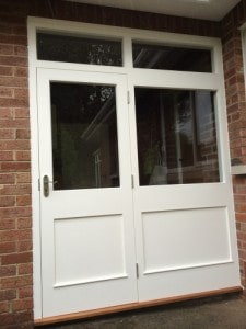 Hardwood, painted, two panel external door with matching frame, side panel and top lights, with toughened glass.
