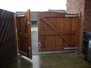 Rear view of sapele hardwood 1/3 and 2/3 driveway gates, 6ft high in Carrickfergus Co Antrim