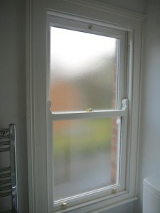 Double glazed, replacement painted hardwood, traditional box, sliding sash window with obscure glass in Belfast