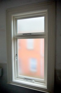 A new replacement double glazed, hardwood casement window with painted finish in Belfast