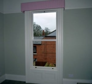 Double glazed, replacement traditional sliding sash window with architrave and panelling in Belfast