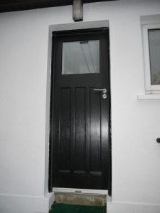 Painted 1930's style external door with double glazed vision panel.