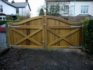 Rear view of curved Iroko hardwood driveway gates in North Belfast