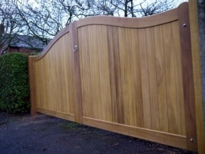 Curved iroko hardwood driveway gates in North Belfast