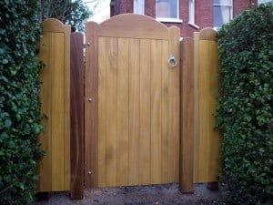 Iroko hardwood garden gate with matching iroko posts and side panels in North Belfast