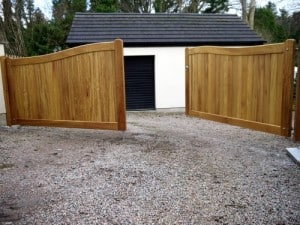 Curved Iroko hardwood entrance gates in Cultra Co Down