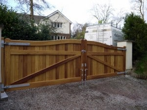 Rear view of curved Iroko hardwood entrance gates in Cultra Co Down